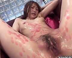 Candle dripped Asian slut sucking on cocks and she loves the freakiness