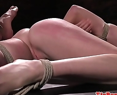 Gagging submissive gets whipped and dildoed