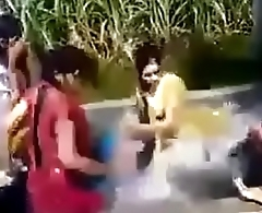 Girls bathing in village motor pump
