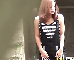 Asian babe watched peeing